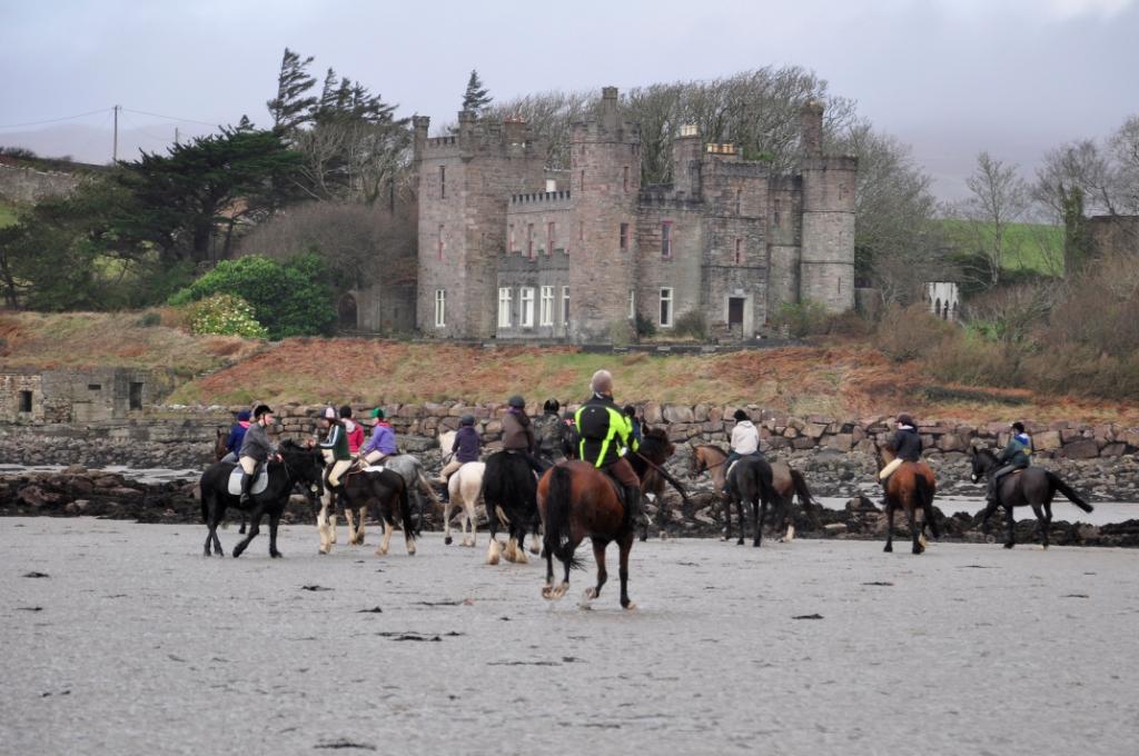 Riders gaze at Rosturk Castle