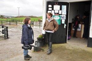Roisin Kelly greets some customers at the stables at they prepare for their horseriding trek