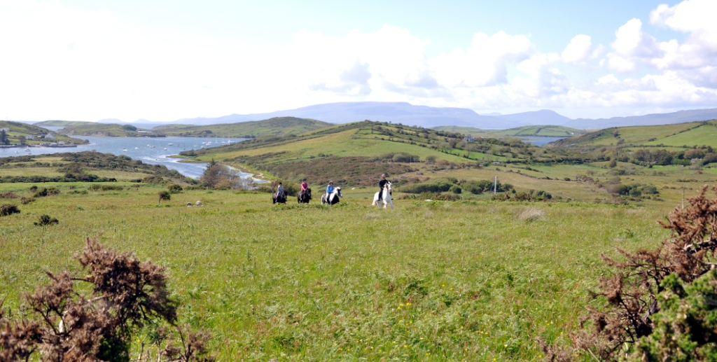 Riders on Rose Hill with Cullenmore Island in the background